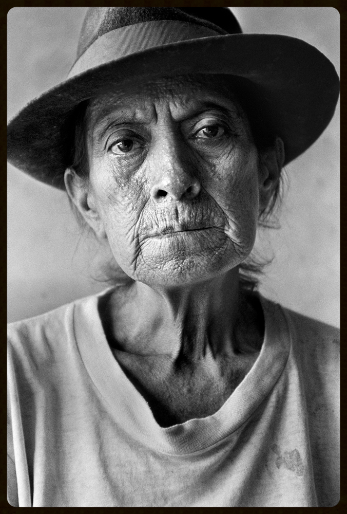 """""""crude reflections"""" Uterine cancer survivor Rosana Sisalima is seen at her home in the village of San Carlos in the Ecuadorian Amazon a year before she died in May, 2006. Her husband died of cancer before her. There was an open waste pit left by Texaco on their land, next to their home, which she believed caused her and her husband's cancer. From 1964 to 1992, Texaco oil corporation, now ChevronTexaco, built and operated oil production facilities in the northern region of the Ecuadorian Amazon, contaminating the environment and devastating communities with irresponsible development practices. Dozens of indigenous and campesino communities continue to suffer severe health effects including unprecedented rates of cancer. Indigenous communities have lost their traditional homelands, and more than 2 million acres of ancient rain forests have been leveled.  photo credit: kayana szymczak"""