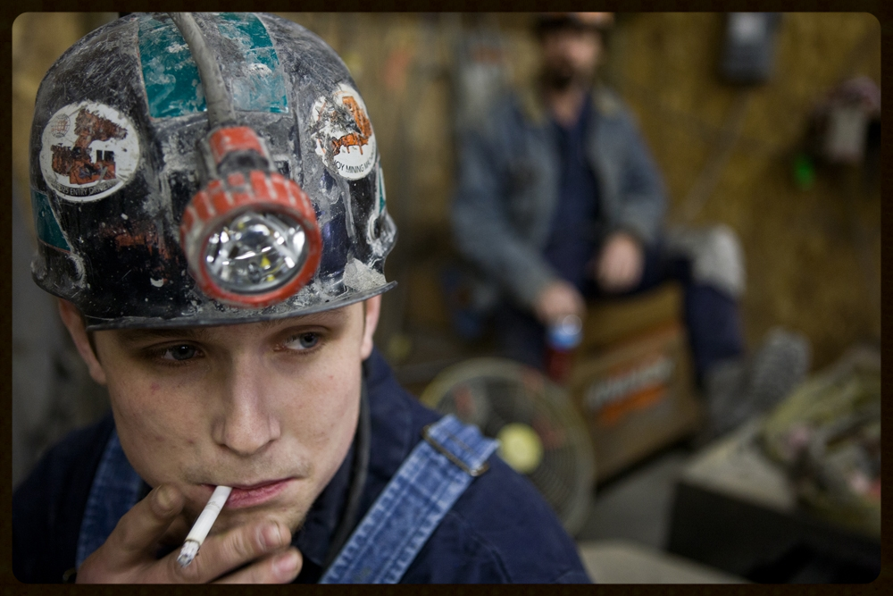 """""""king coAL'A PRECARIOUS REIGN"""" -Coal miner Chuck Ewing smokes a cigarette before his shift at the Tusky coal mine in Urichsville, Ohio. Seventy men work at the Tusky underground coal mine in rural Eastern Ohio, caught between the growing consequences of global climate change and the limited employment choices in a still-depressed economy.  PHOTO CREDIT: KAYANA SZYMCZAK"""