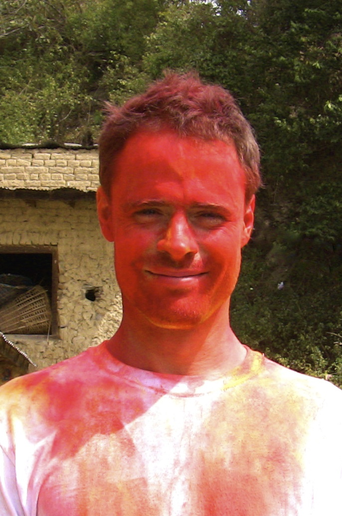 Holi in a poor Nepalese village, and all they could afford was red. And it smelled like gasoline. All those bright Holi colors are made of the same petrochemical derivatives, and should be banned. Traditionally it was  herbal powders  or food extracts that were used.So it's also a picture of mind over matter. Smile and celebrate despite smelling like gasoline (mostly because everyone else does too!) - todd caldecott