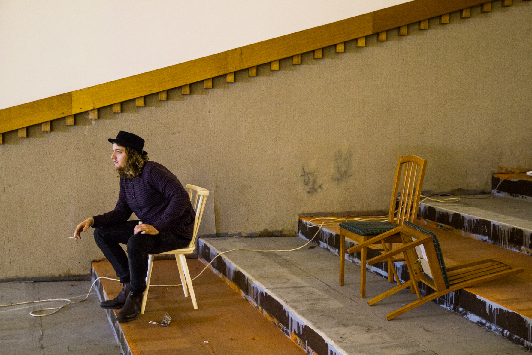 Kacee Heidt enjoys a quiet moment and cigarette between takes.