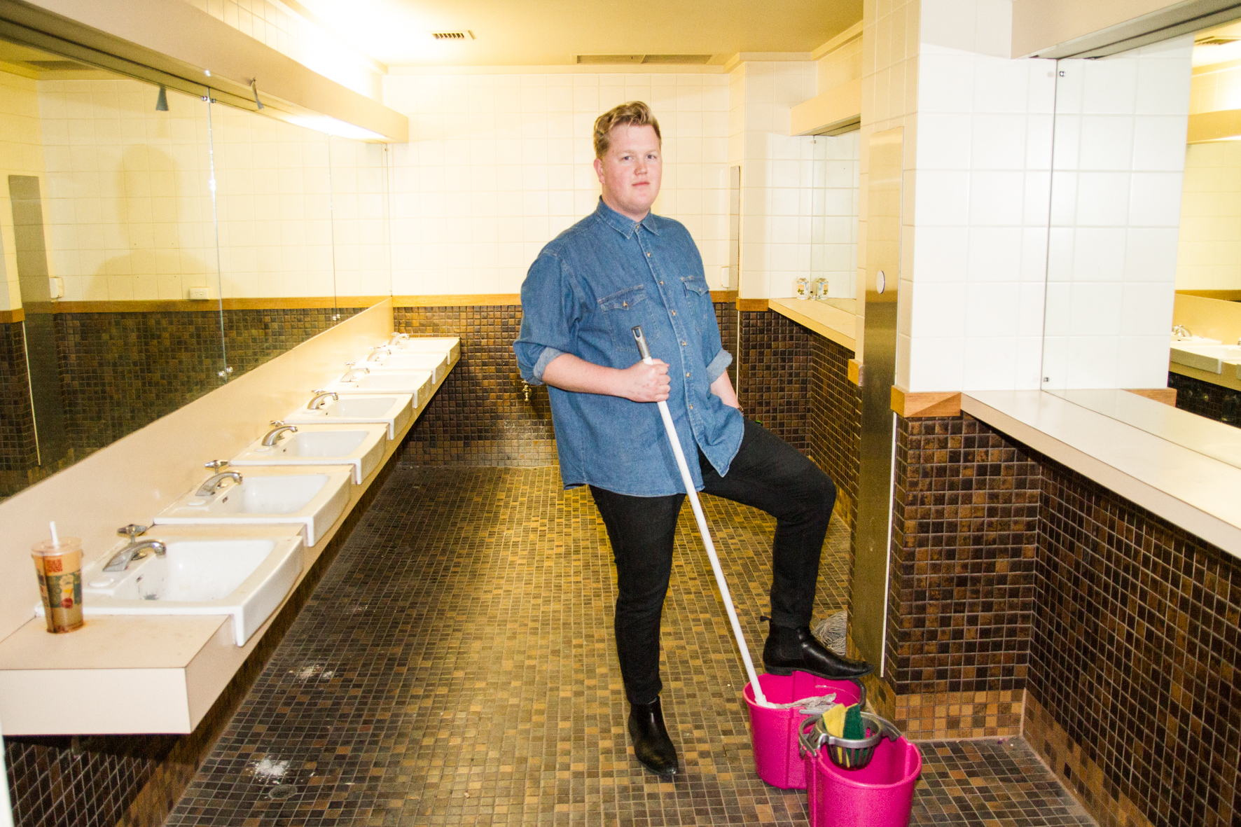Oli Kirk poses as a cleaner on a piss break.
