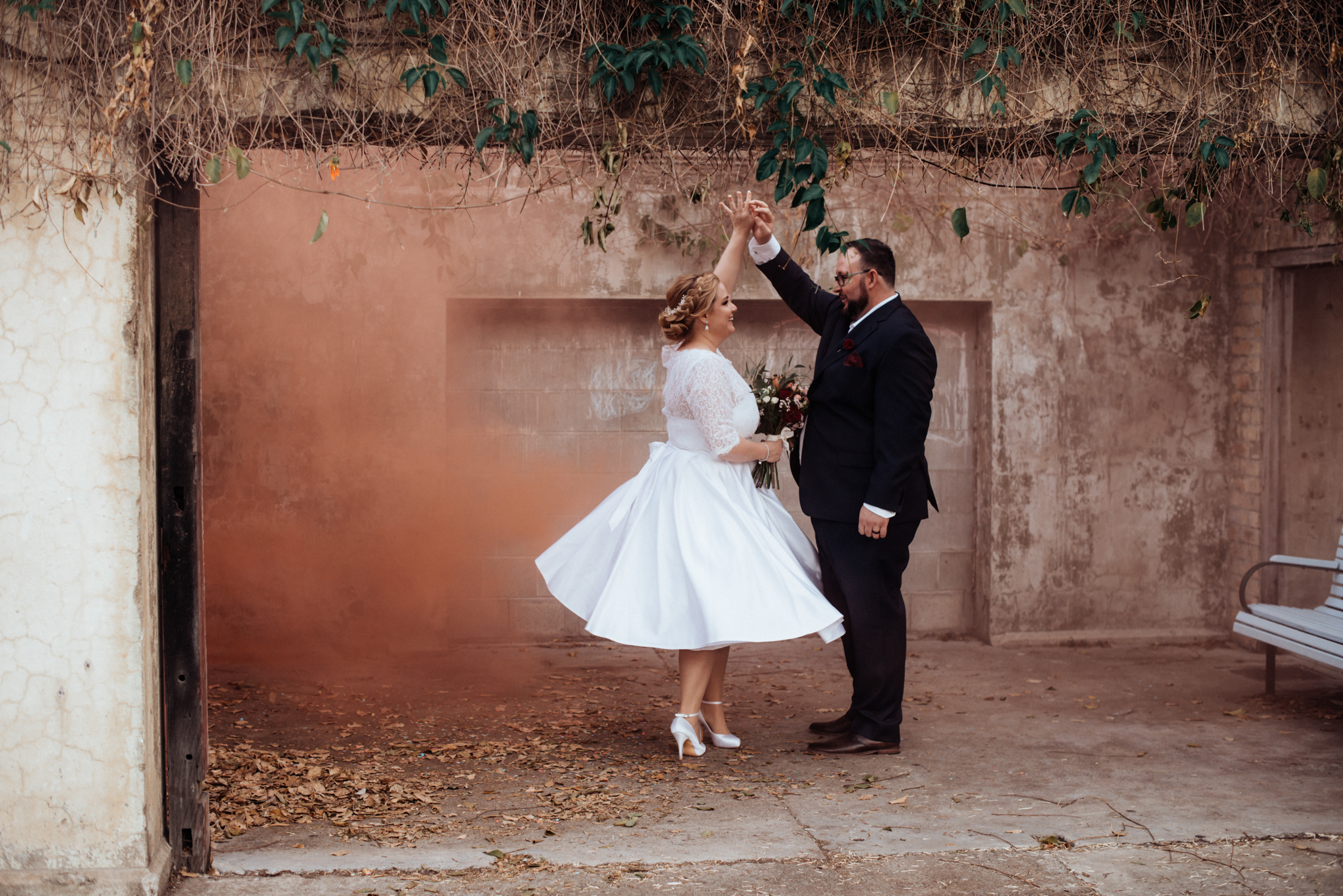 Orange Smoke in the City - It is easy to control the movement and density of the smoke within an enclosed space. An orange smoke bomb was placed against the wall to create a peachy backdrop for these two newlyweds. The smoke bomb was securely placed in a mason jar and was properly disposed off afterwards, leaving no trace behind in this urban public space {more on that below}. A lot of public spaces have regulations for the use of smoke bombs, similar to regulations for the use of fireworks, so be sure to check before shooting.