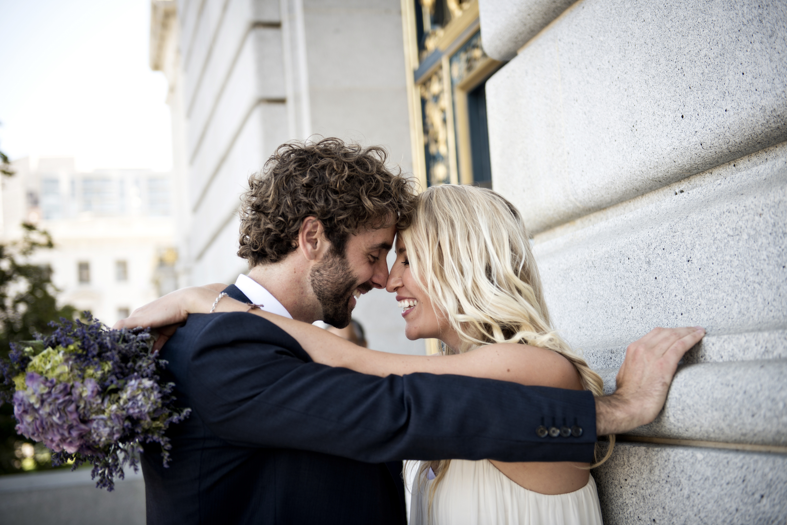 Stephan & Andrea enjoy their time outside of City Hall after having their wedding at the rotunda inside.