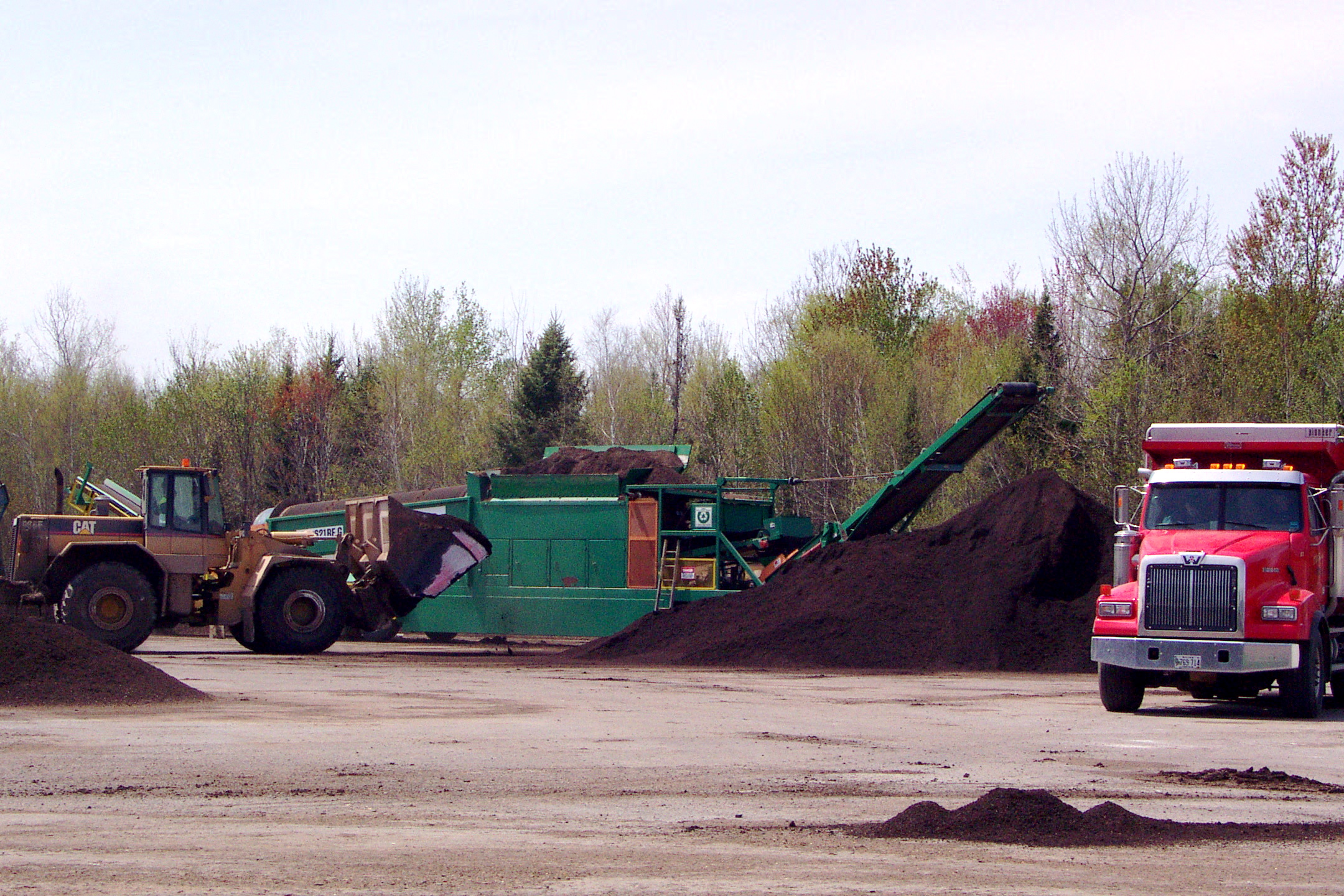 Screening biosolids compost