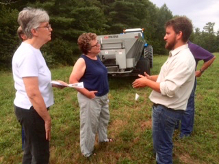 Mike Potash of RMI (right) explains the land application process at a field site in Gilmanton, NH.