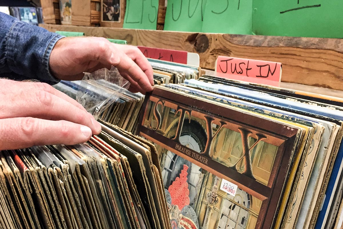 Browsing through records at Charlemagne Record Exchange | Photo Credit: ©Find. Eat. Drink.