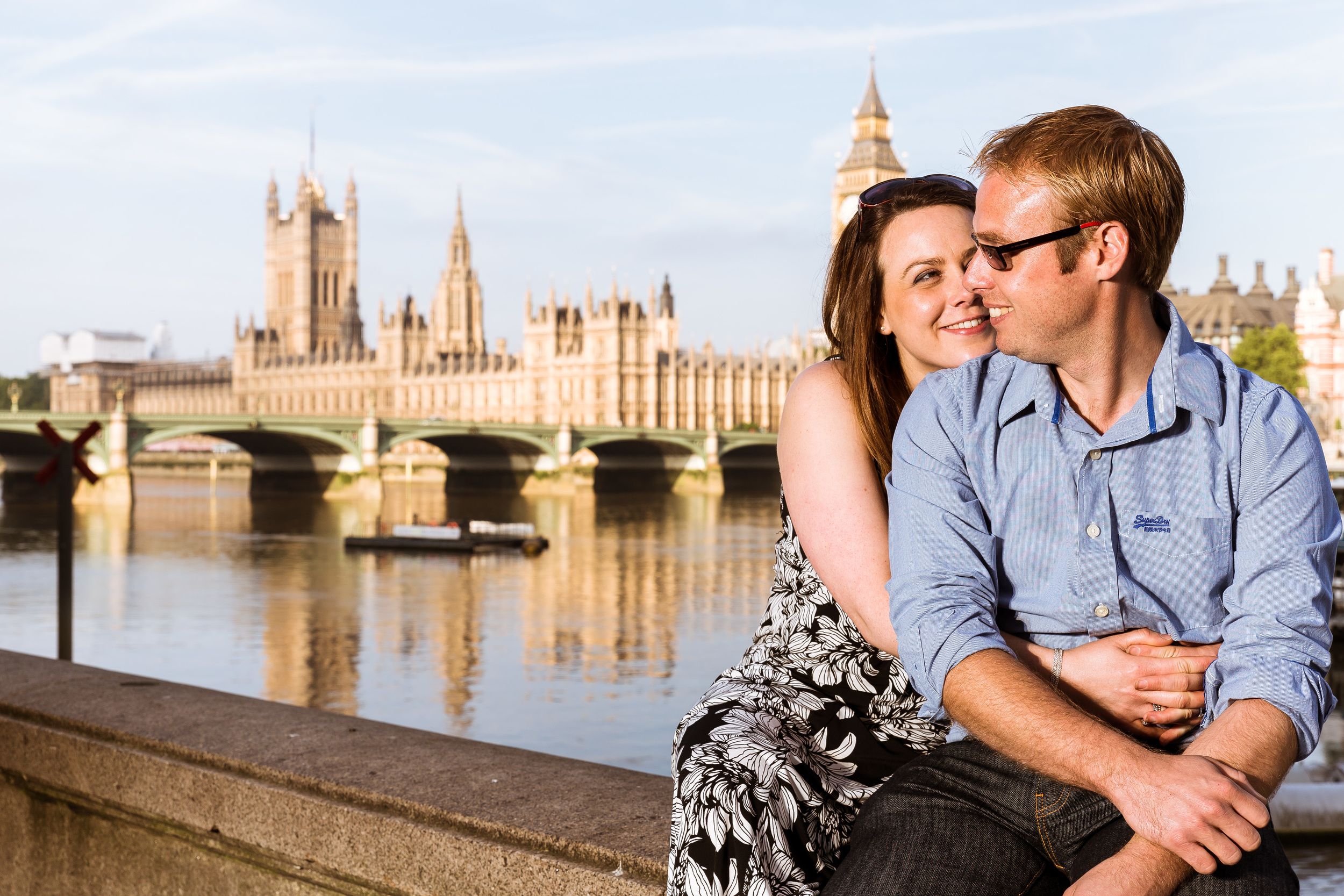 Marc & Sarah Sitting on the bank of the Themes over looking Westminster