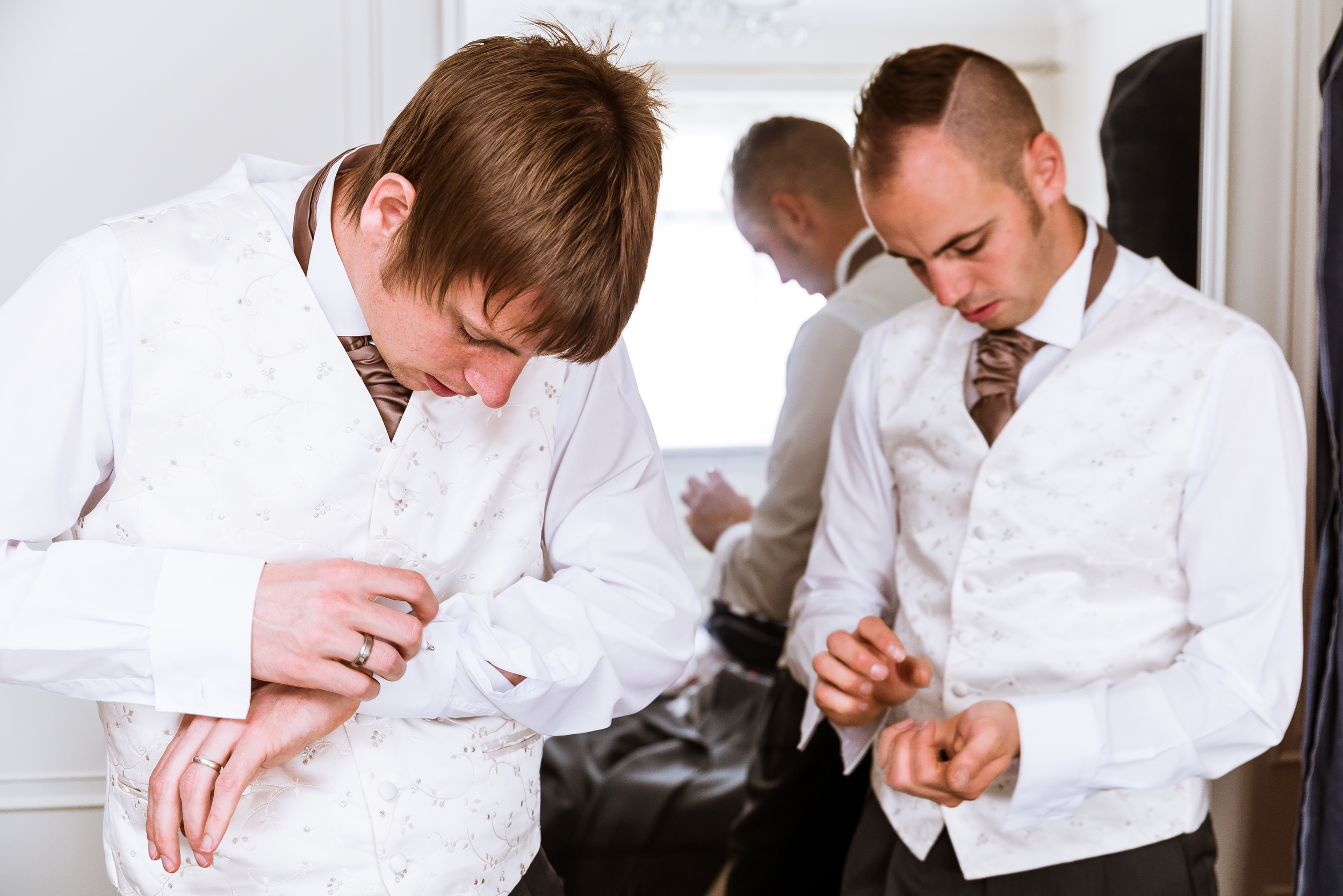 Dave the best man and his brother trying to do up cufflinks
