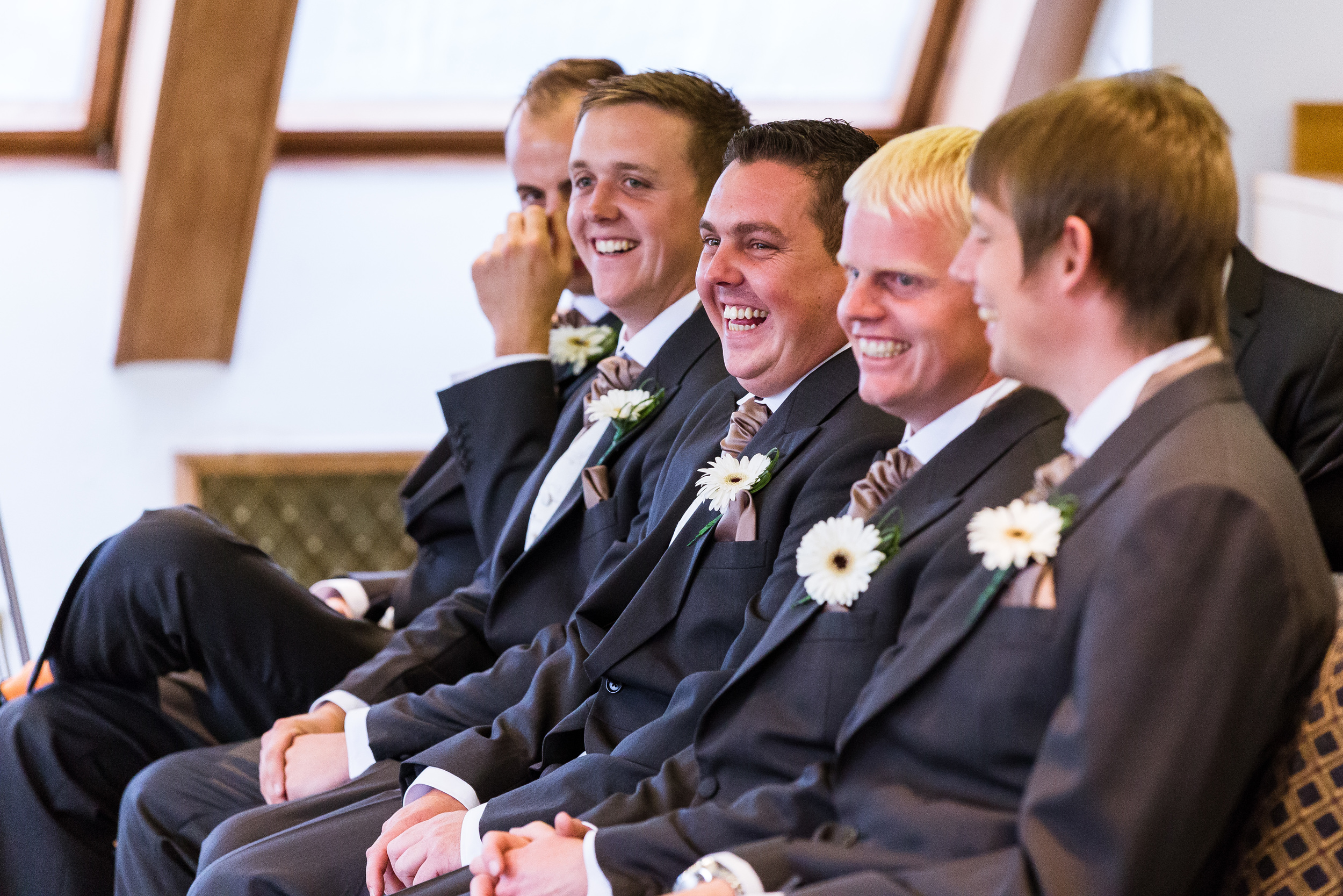 The groomsman's reaction to Marc's fumbling off words