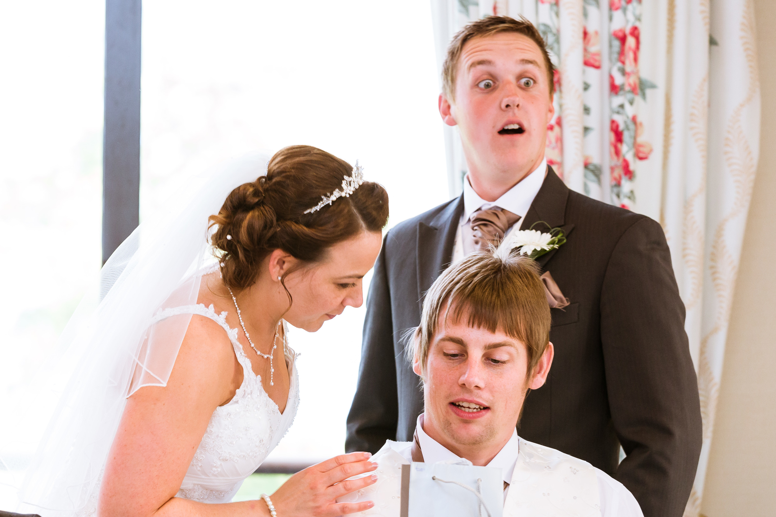 Sarah is passing out gifts too the grooms man, gavin one of the ushers is shocked to see what it was