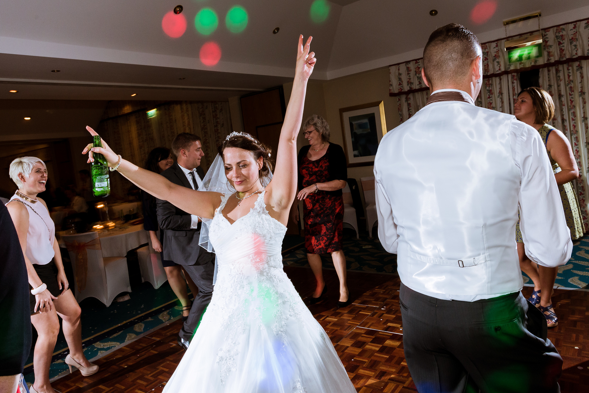 She continues to celebrate their wedding as the night goes on, with her hands in the air the party never stoops