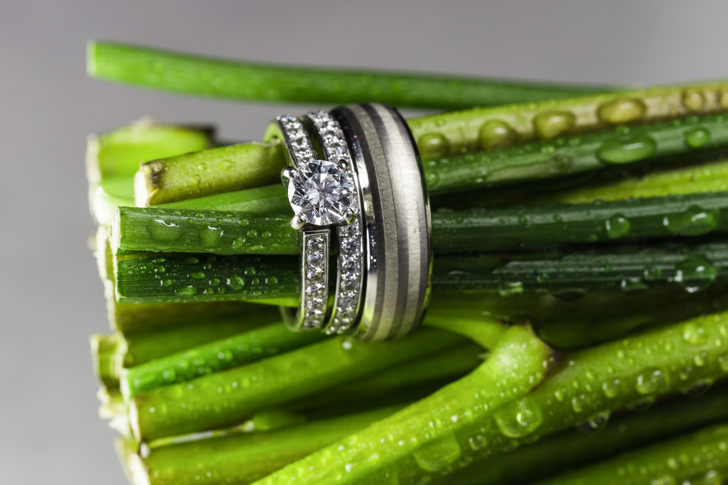 I love shooting details, i take the time too shoot the rings on or with things that mean something too the bride. I put the wedding bands on the brides bouquet