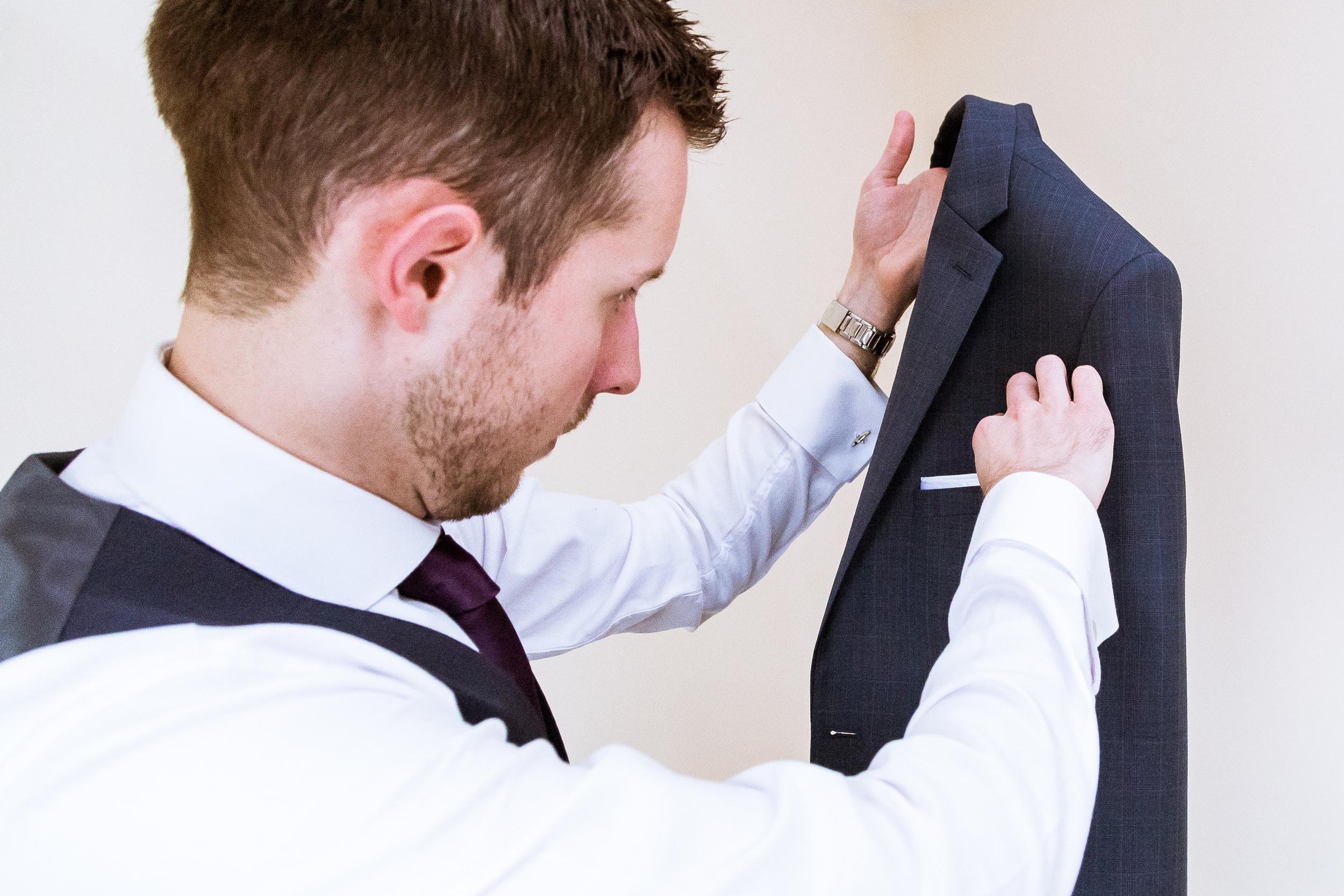 Groom - Prep - Suit going on -  wedding