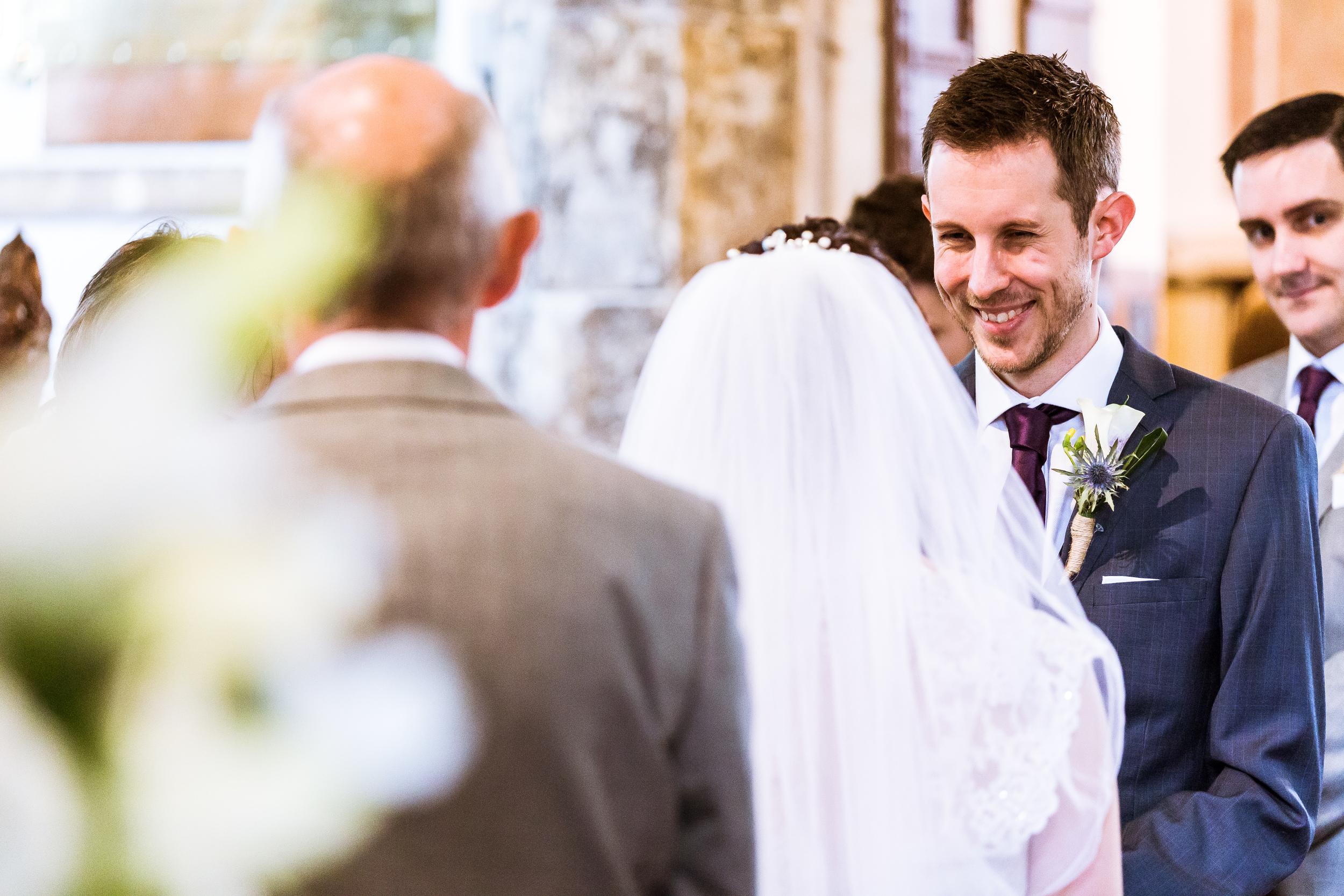 Church wedding in kent, groom looking at wife