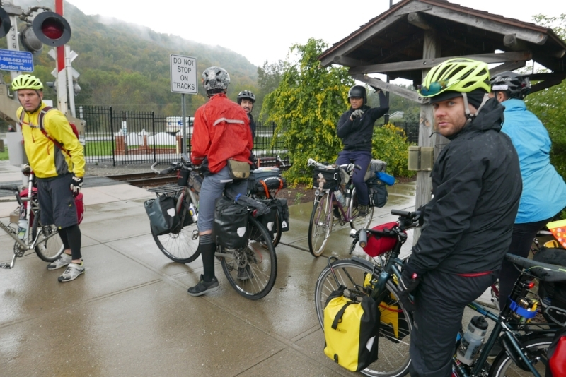 The group of 14 of us disembark into steady rain, and low-40 degree temps.