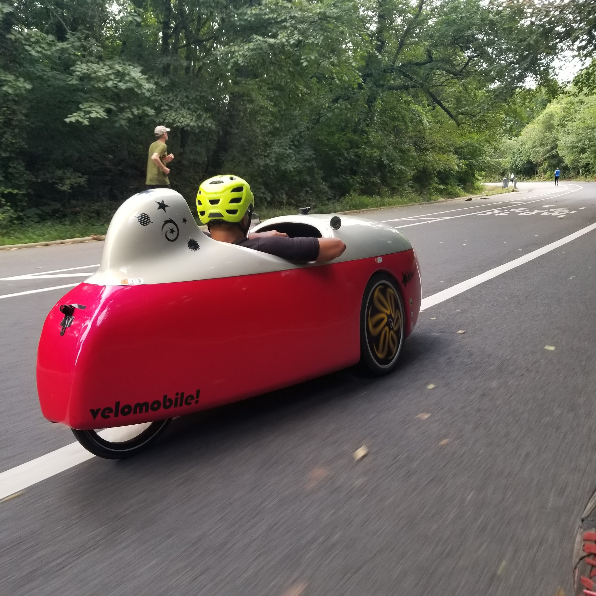 Mr Dubin, riding his Velomobile that just received new suspension and struts at  718 Cyclery