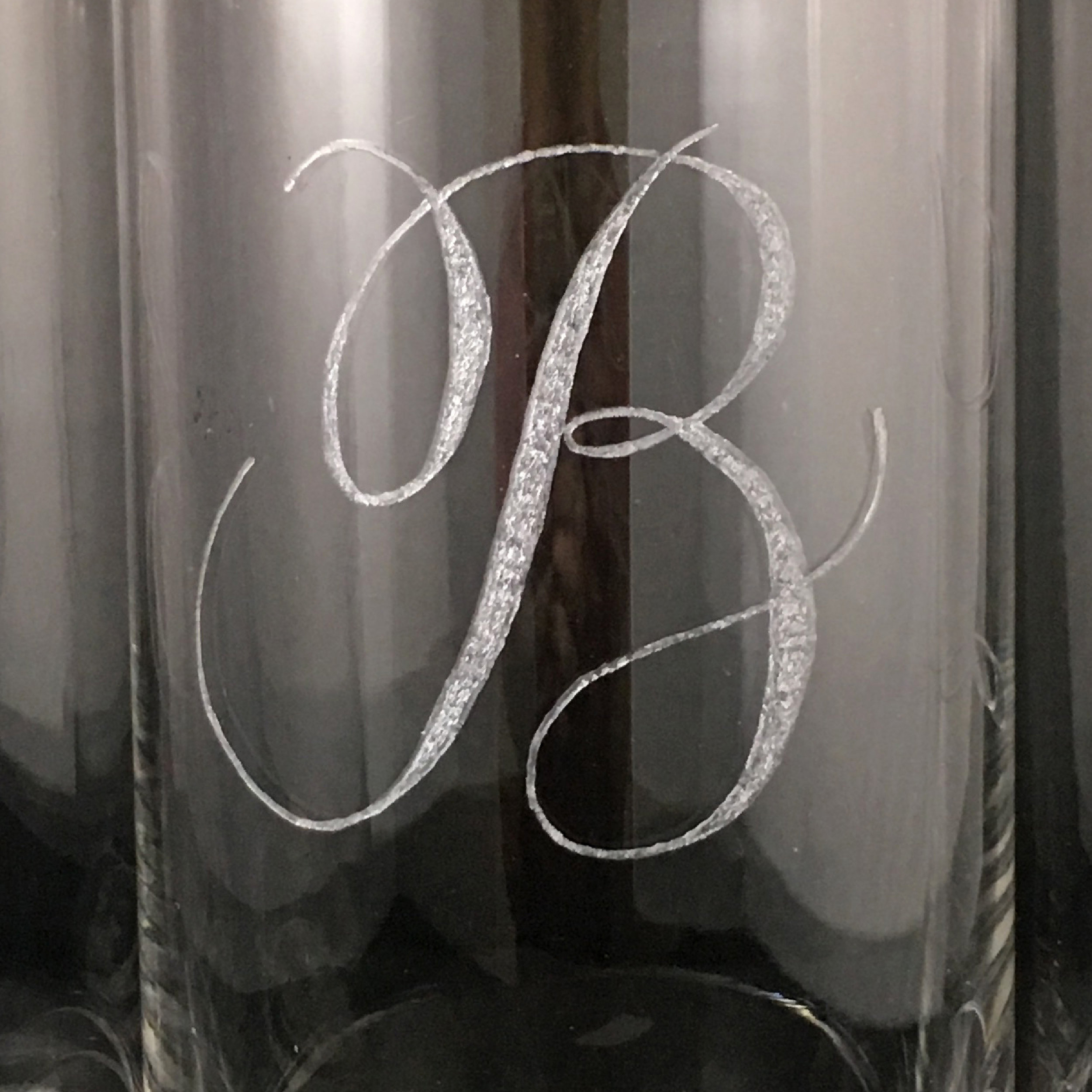 The bride and groom's logo that my client asked be to engraved on the bottle.
