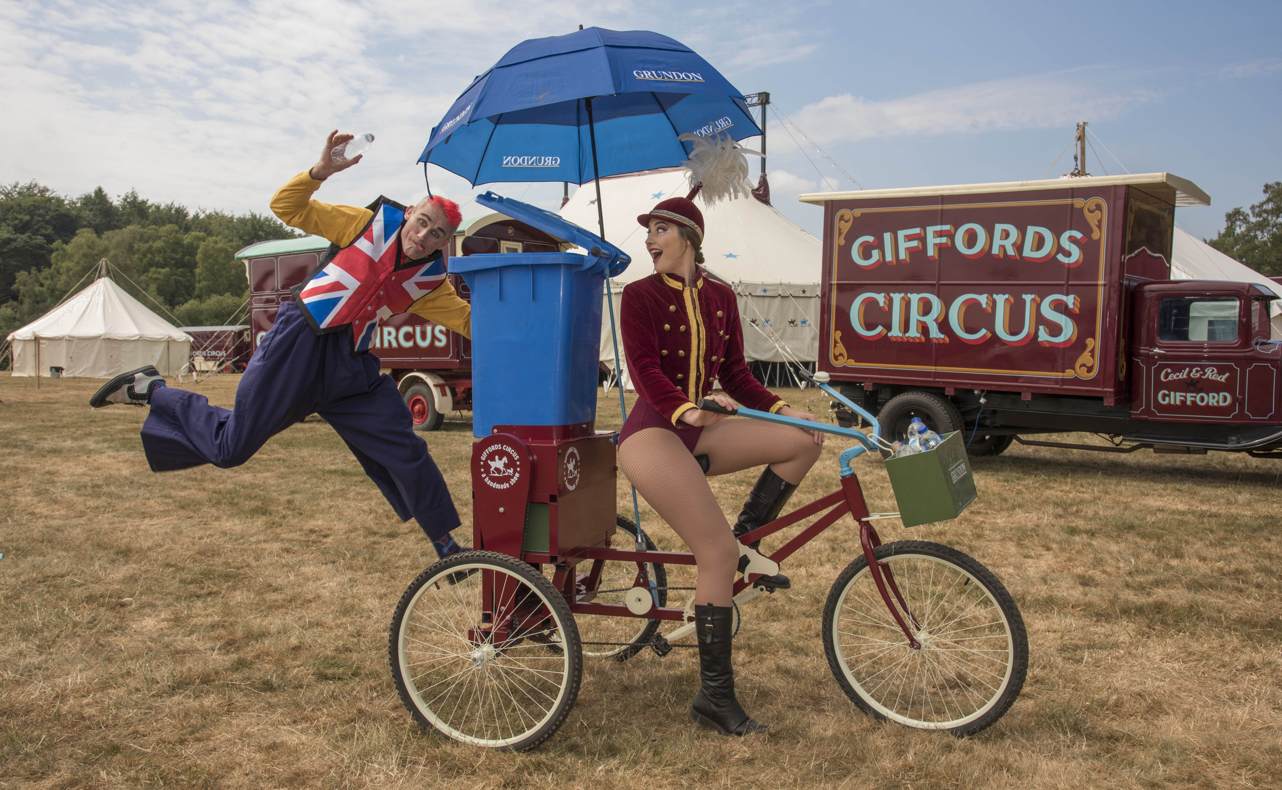 Tweedy the clown and showgirl Lizzie on the Recycle Bicycle