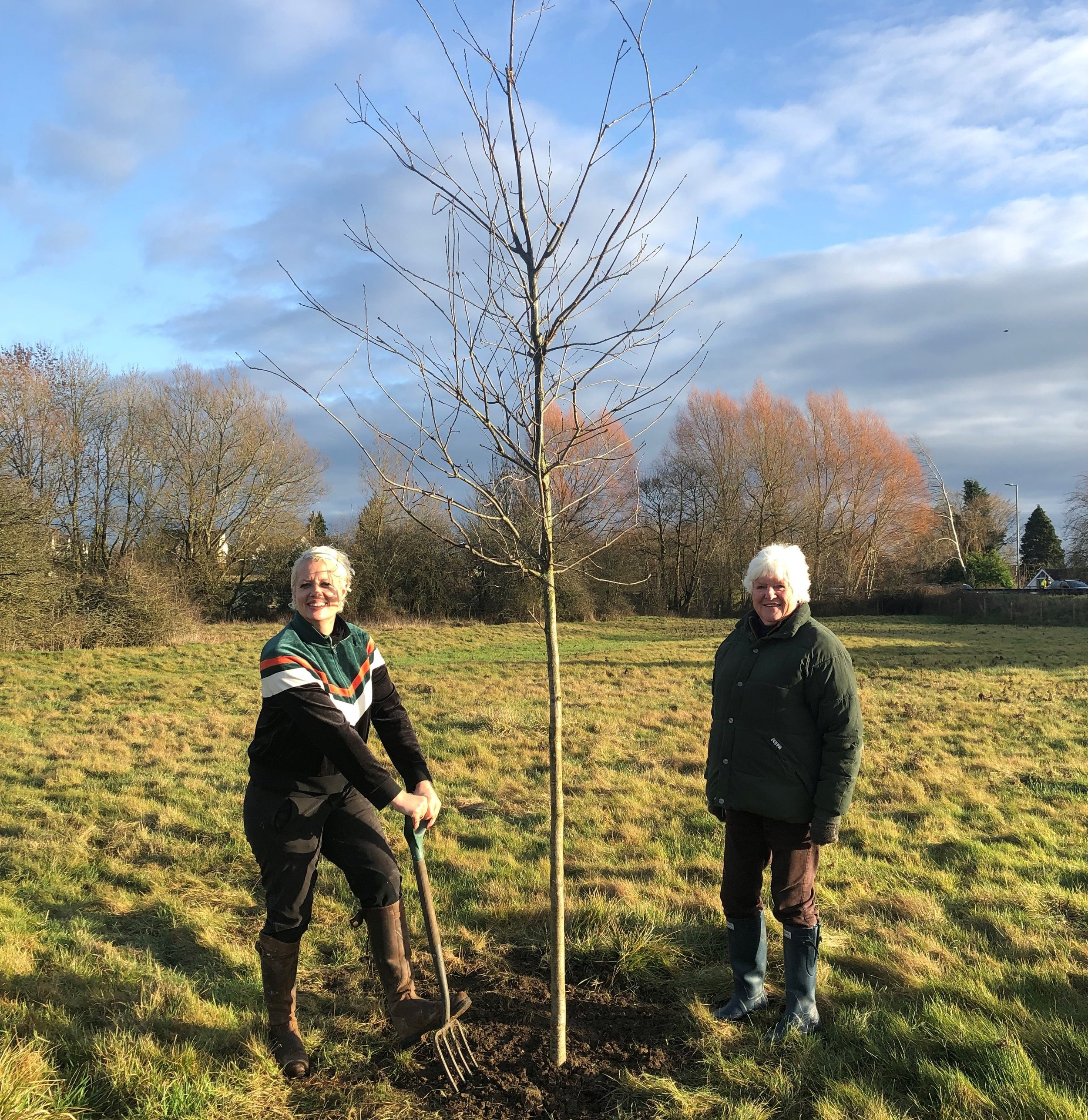 Nell Gifford planting an oak tree at Stratton Meadows with owner Sarah Holland