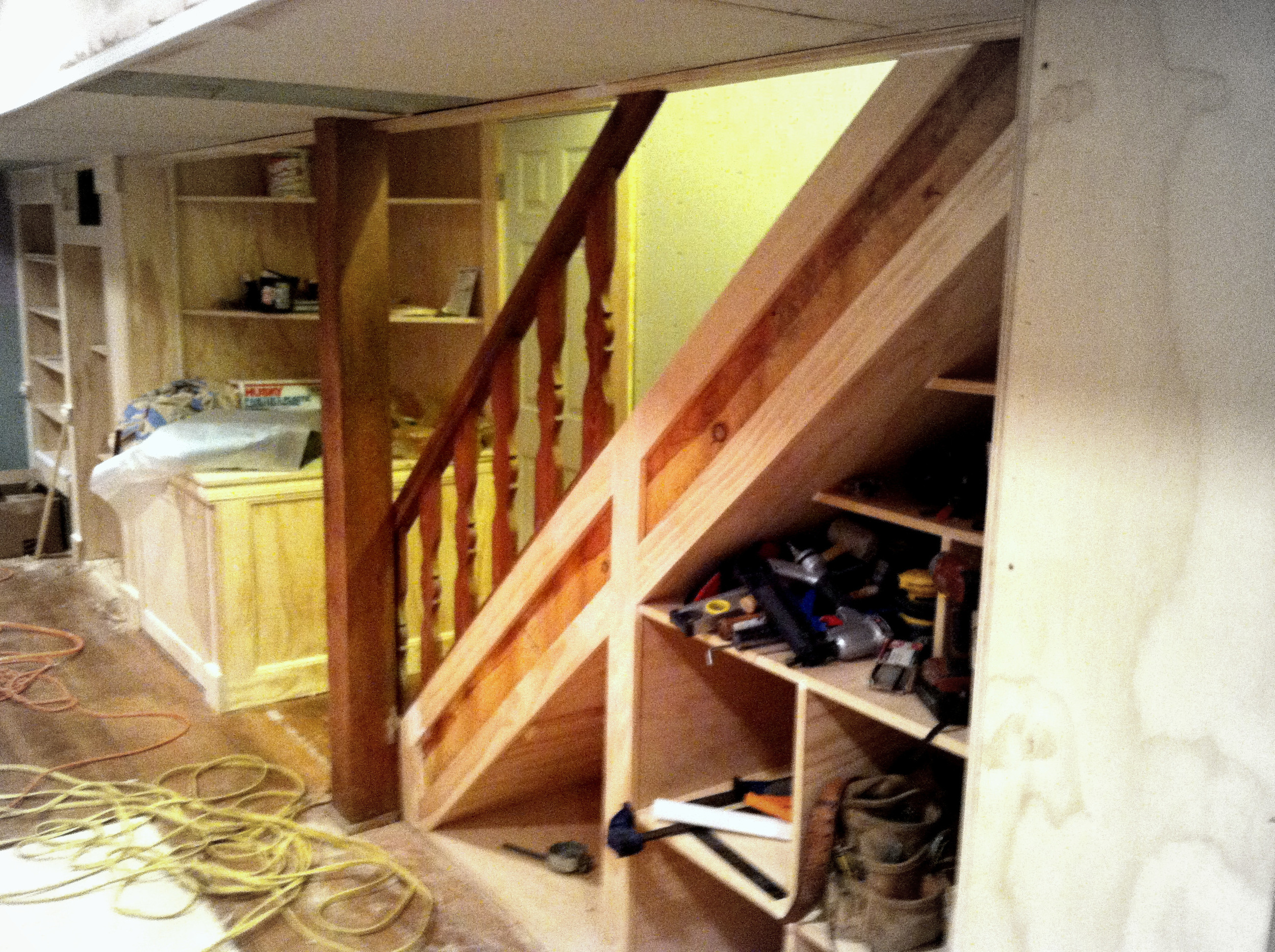 New basement stairs constructed with storage nooks below