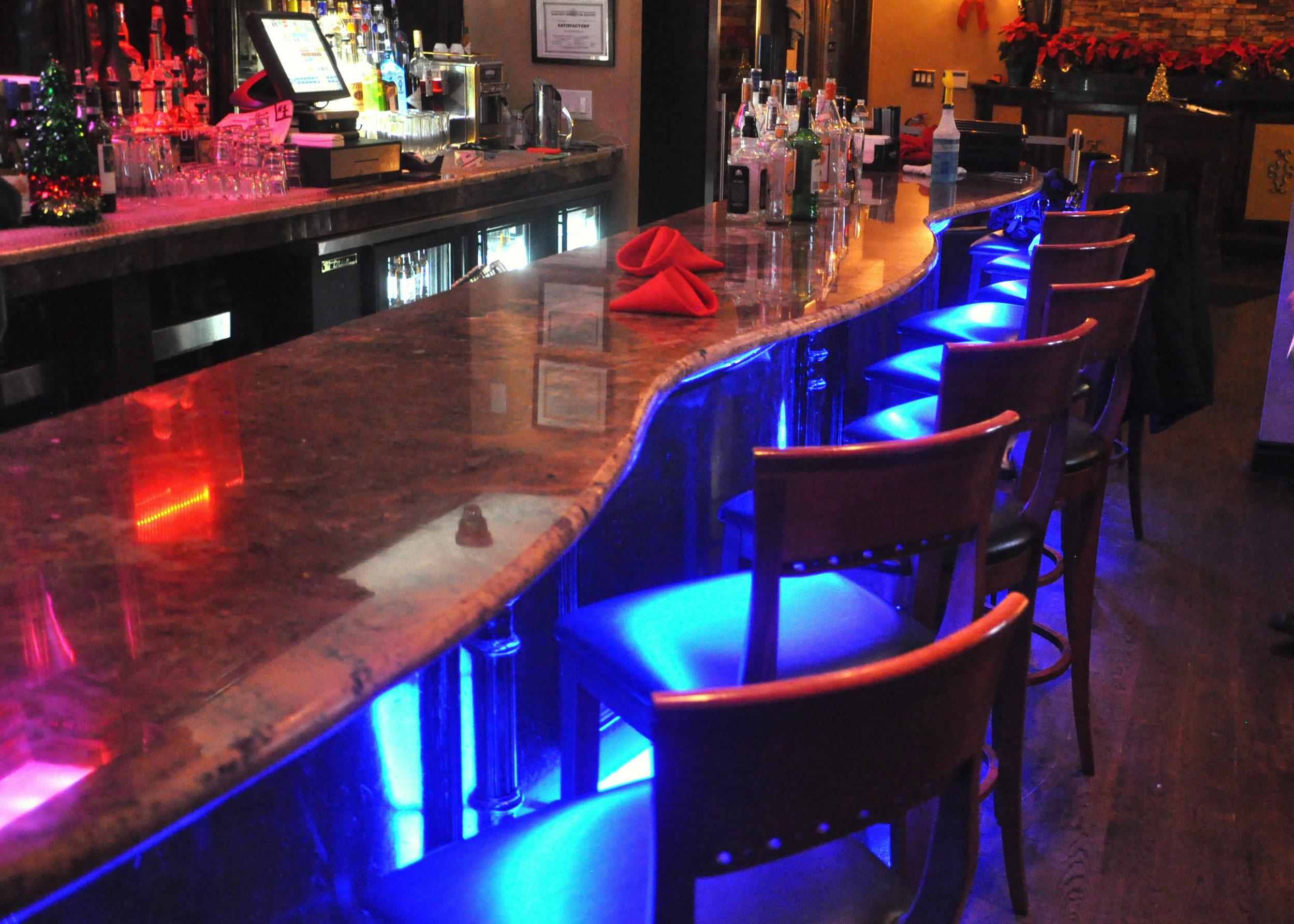 Finished bar with dark high gloss stain and neon lights