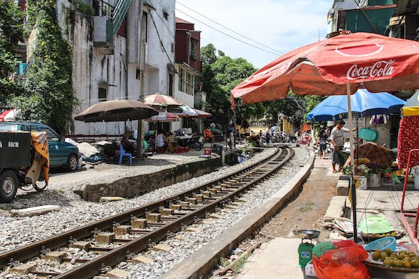 Life intermingles with train lines in Vietnam