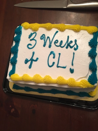 "Molly provided a  festive cake celebrating three weeks of ""CL"" or commune life."