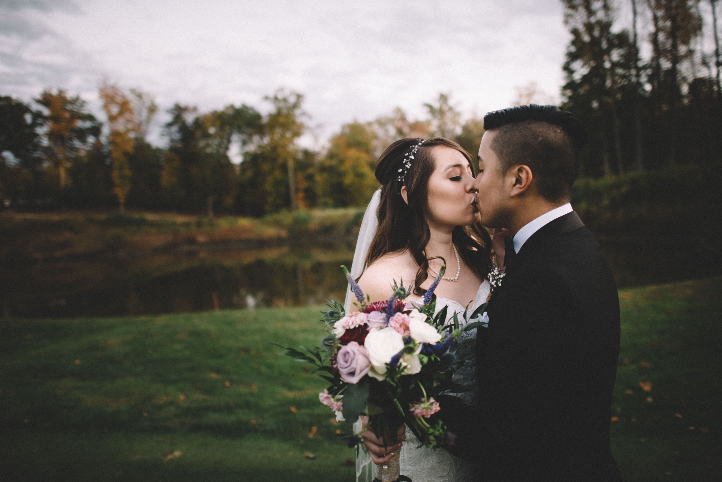 The bride and groom share a kiss on their wedding day.