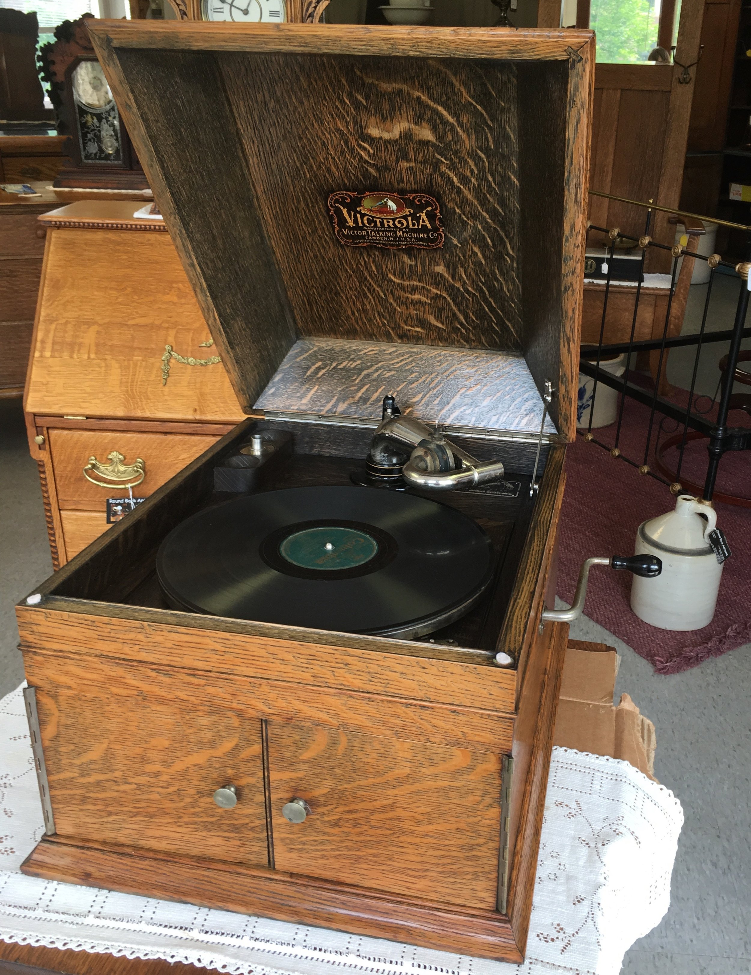 Early Victor Talking Machine with hood. Very attractive oak wood cabinet.