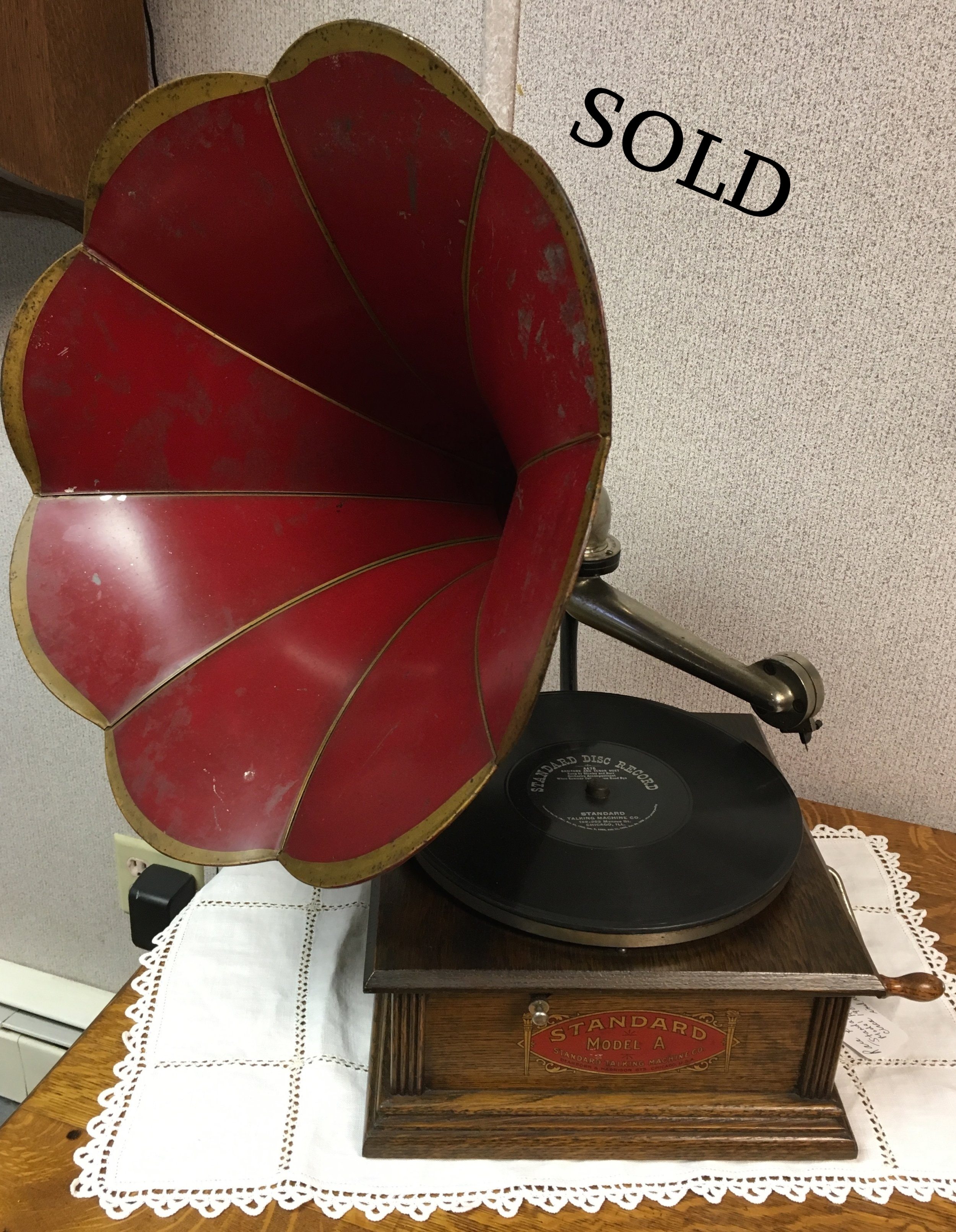 This is an old time crank phonograph that is called the Standard Model A. They were made in the early 1900's.