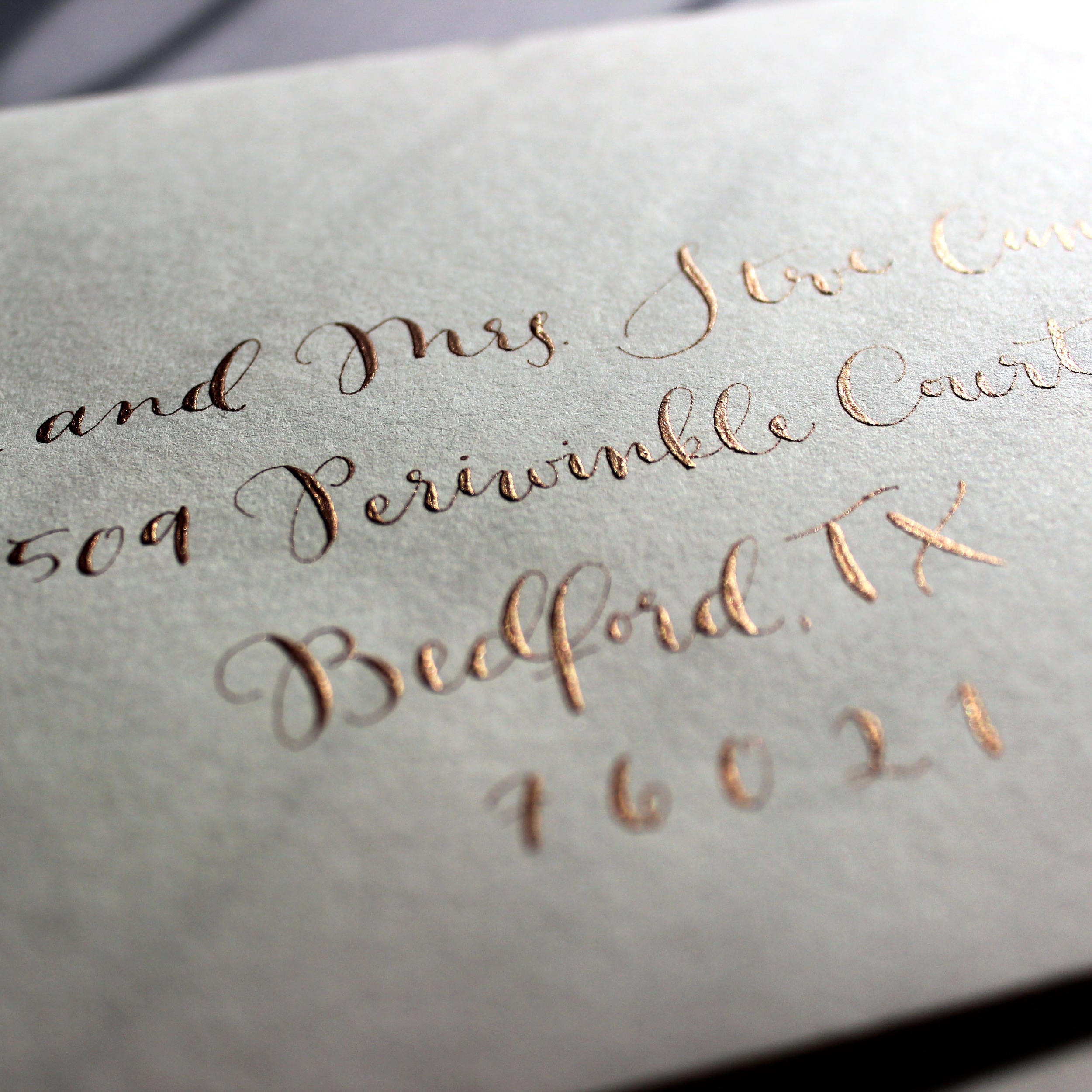 Modern Copperplate Calligraphy in Copper for Wedding Invitations by Ashley Bush