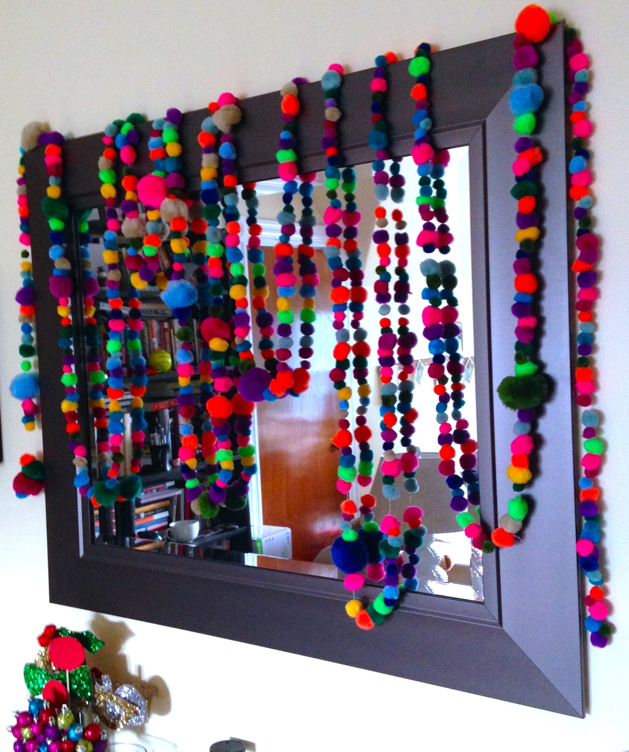 Garland isn't just for the tree! Carefully style it around your house to make every room a little more merry!