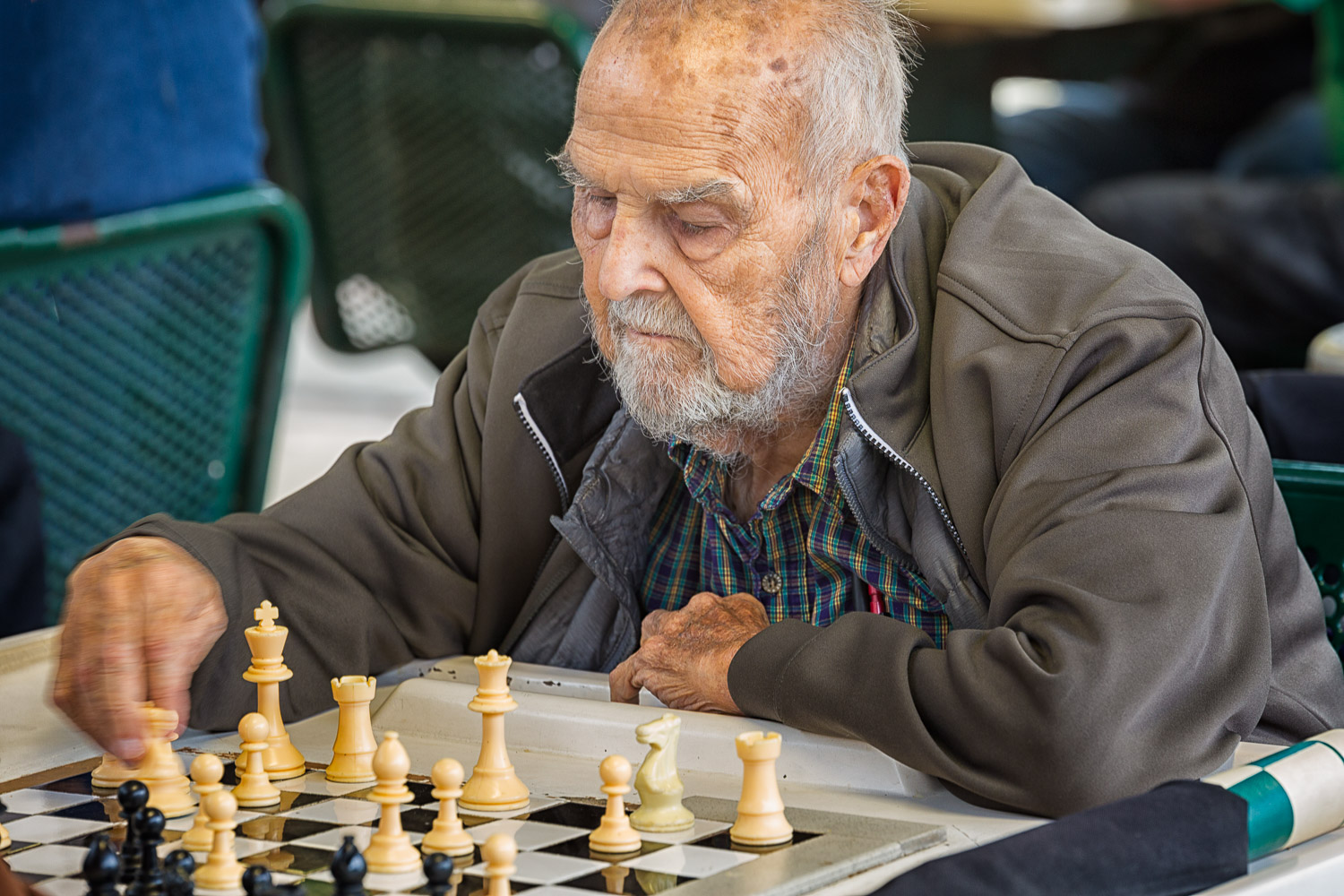 Here you can see that chess is an action sport by the motion in the man's hand.