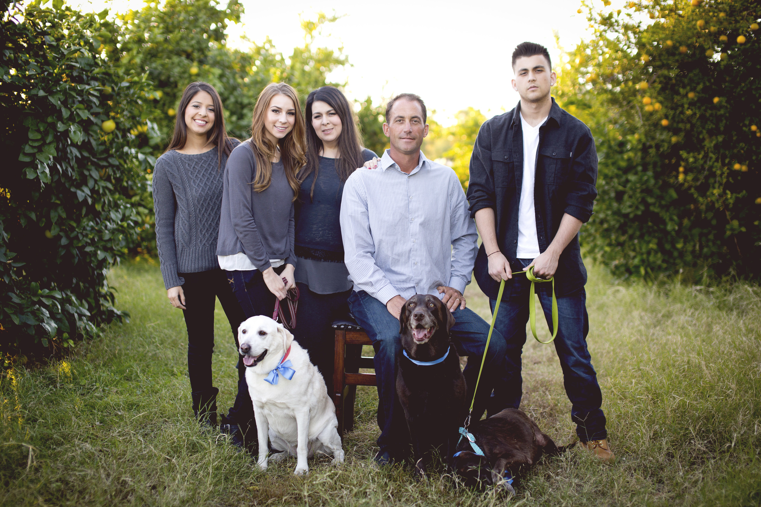 This is our family. We have two daughters, Lacey and Alexis, and a son, Colten. We adore our labs, Darli, Molly Sugar (not shown  here) and Prunella.