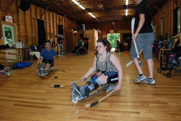 Adapted sports like luge hockey are fun, safe and fulfilling for all campers.