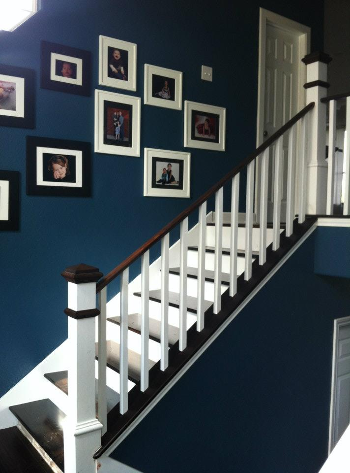 Steps 2 and 3: Replace the stair rail and change the carpeted stairs to wooden treads and risers.