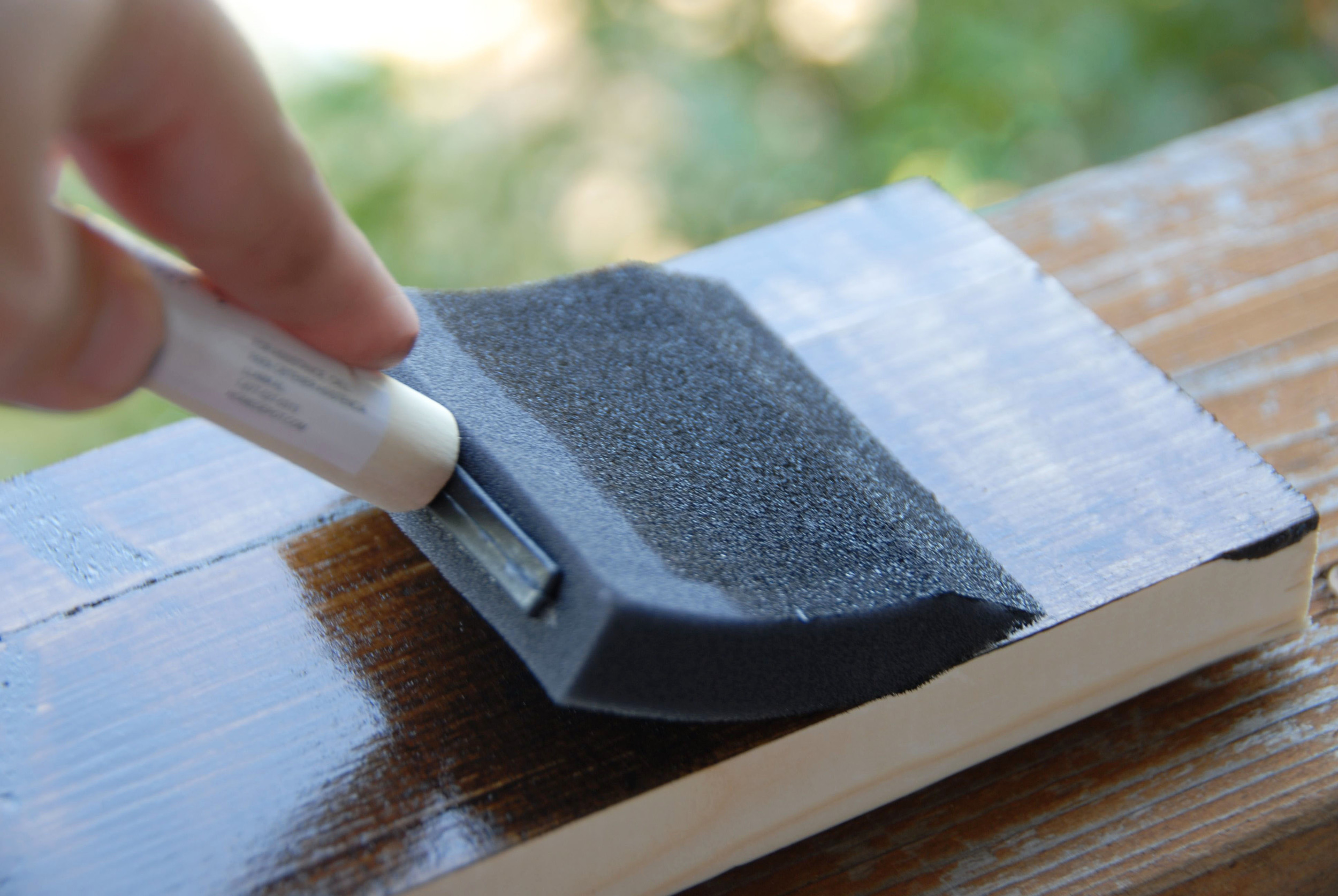 Using a wider sponge, wipe the board from edge to edge (doing this will even out the stain). Note: Do this immediately. If you let the stain sit it will get tacky.