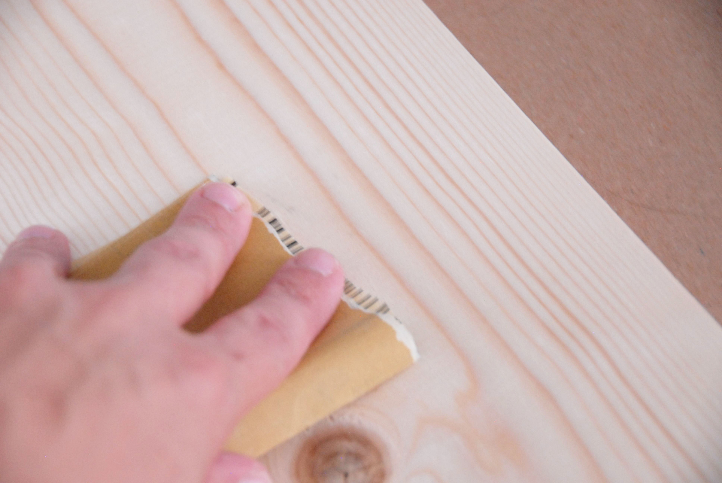 Sand the boards with fine grit sandpaper. Remember to sand with the grain.