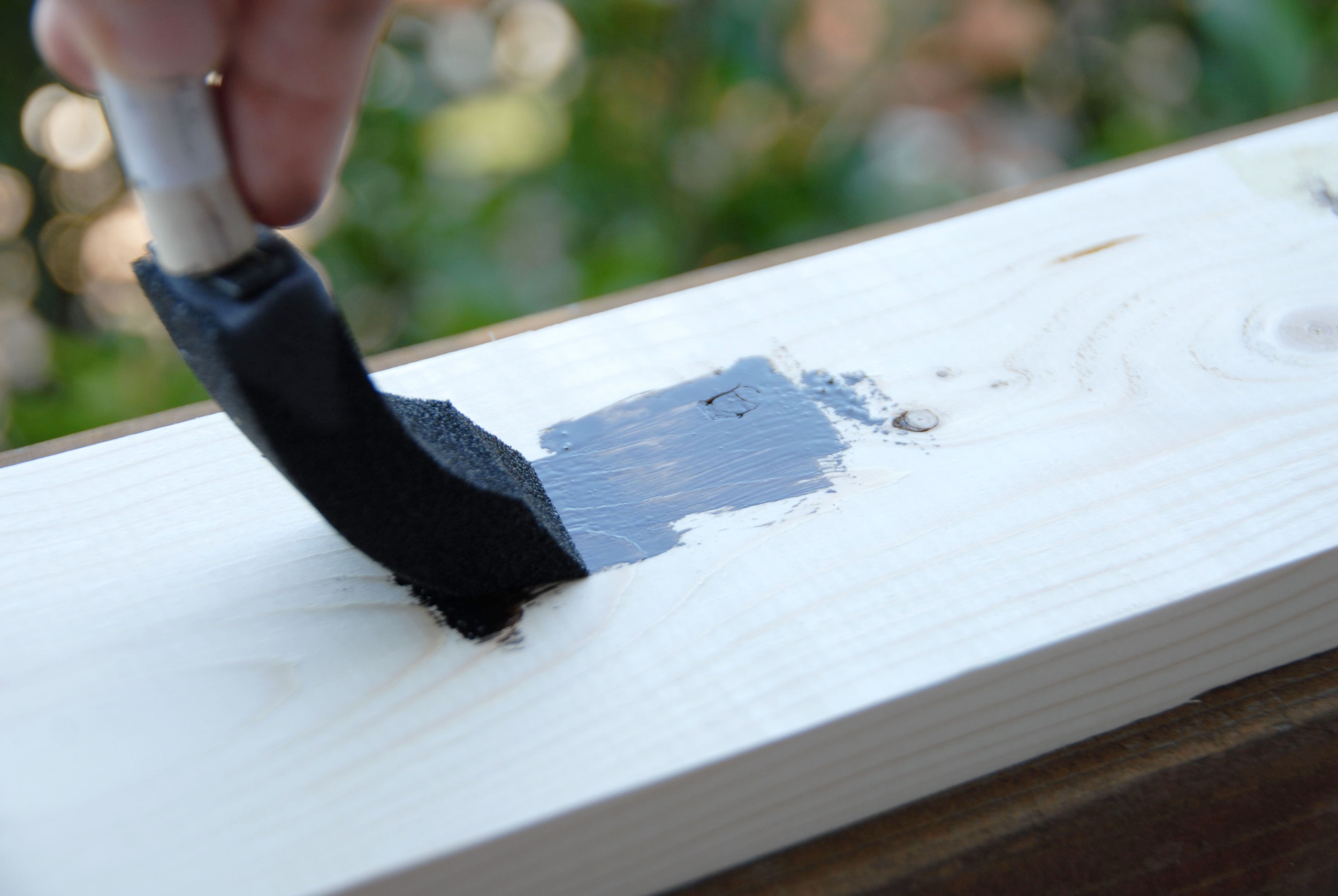 Apply a thin coat of stain, going with the grain, to the boards.