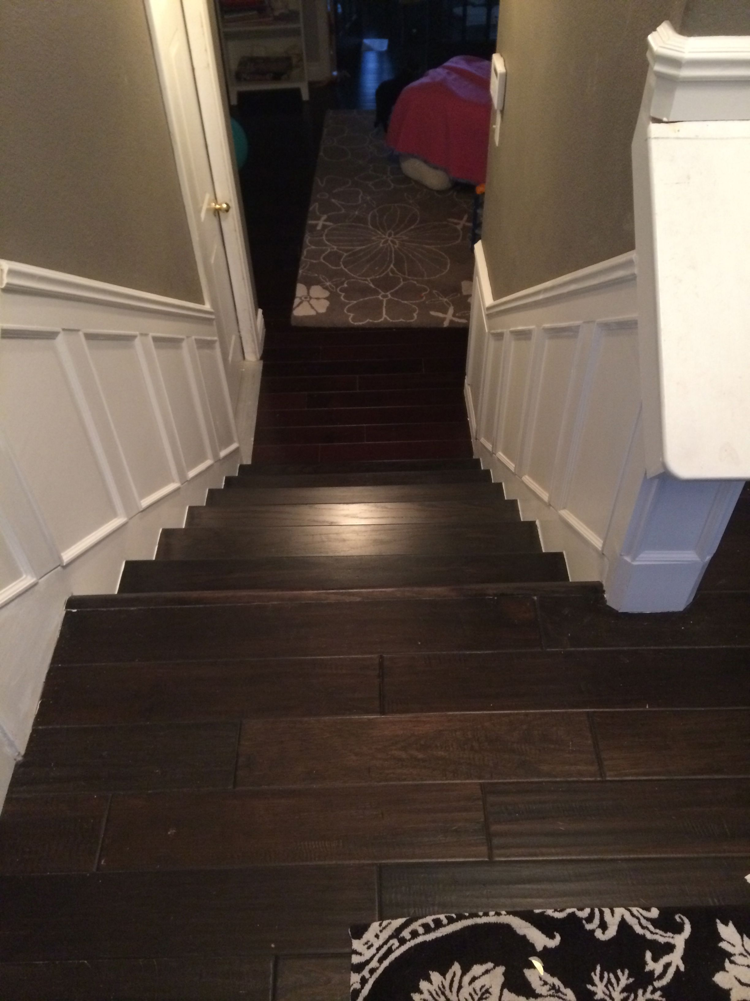 Step 10: Continue the wainscoting from the foyer to the lower stairs.