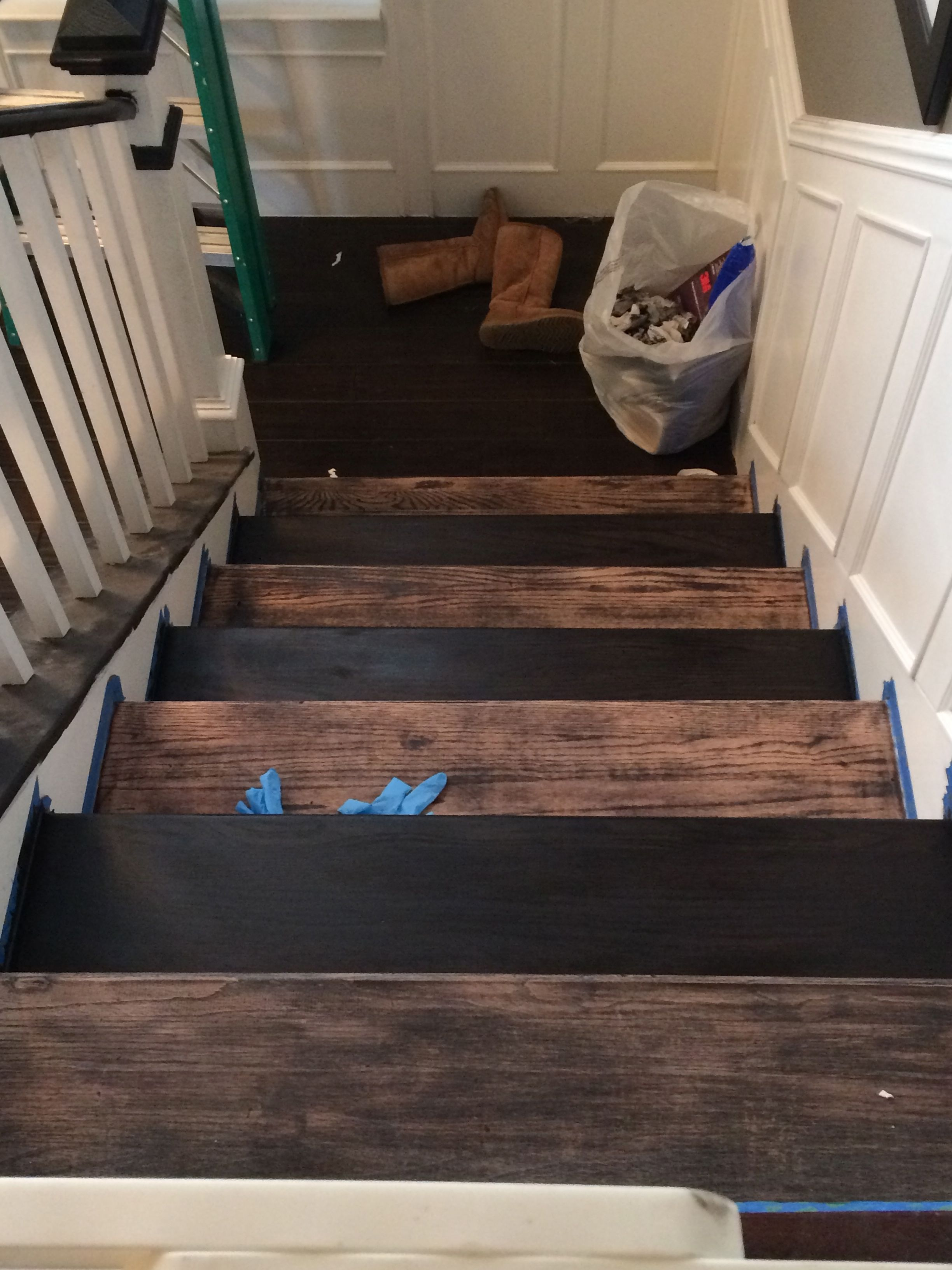 Stain every other stair so you can still use them.