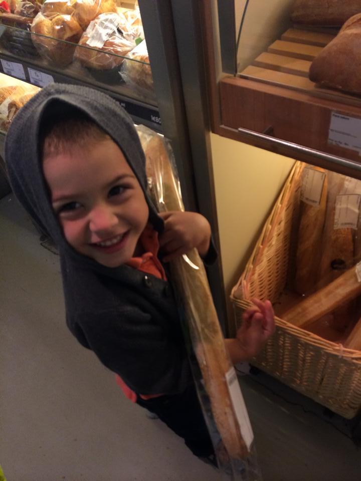 Little man grabbing his fave - baquette!