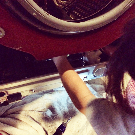 This is me... changing out the drain pump in the washer.