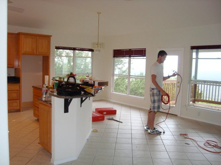 A pic from when we actually moved in and my baby brother came over to help demo all of that tile.