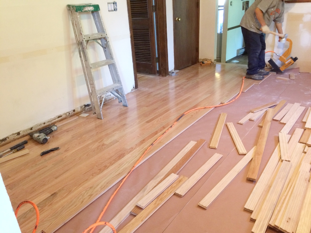 WIP: Red Oak hardwood floors that match the rest of the house was installed prior to the cabinets.