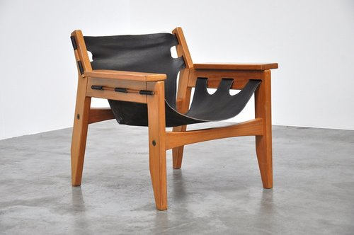 Kilin chair for his firm, Oca Industries, in Brazilian pine and leather, 1973  (   source   )