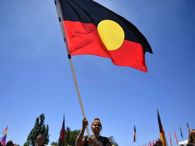All WA police stations will now permanently fly the Aboriginal flag. Image: AAP