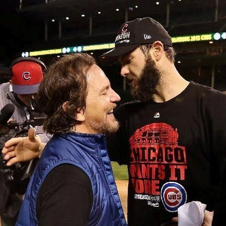 Eddie Vedder celebrating with Cubs ace Jake Arietta after the big win...