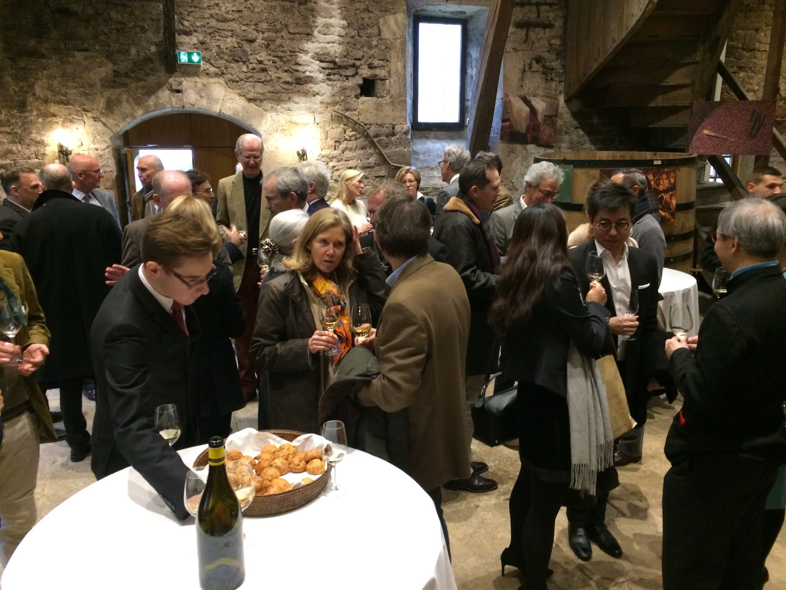 An apéritif before the Paulée, at Drouhin in Beaune (the old press house, complete with working press from the 1500s)