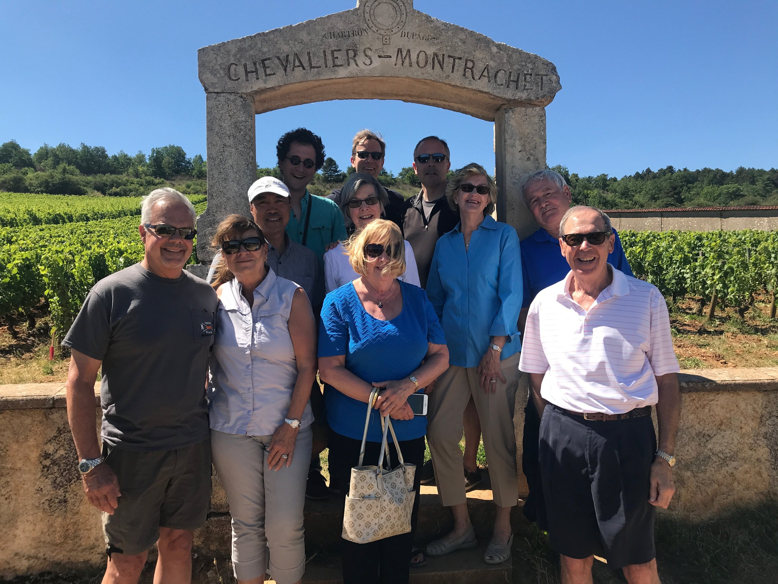 Our annual group shot in the arch at  Chevaliers-Montrachet